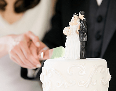 A bride and groom cutting a cake