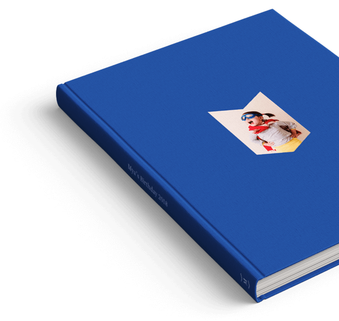 A blue photo book created by Motif